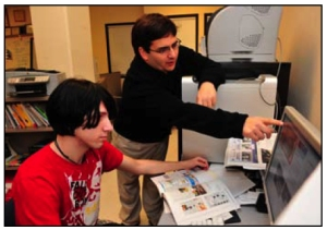 Darren working with Thomas Johnson (no relation), who designed the Campus News template.